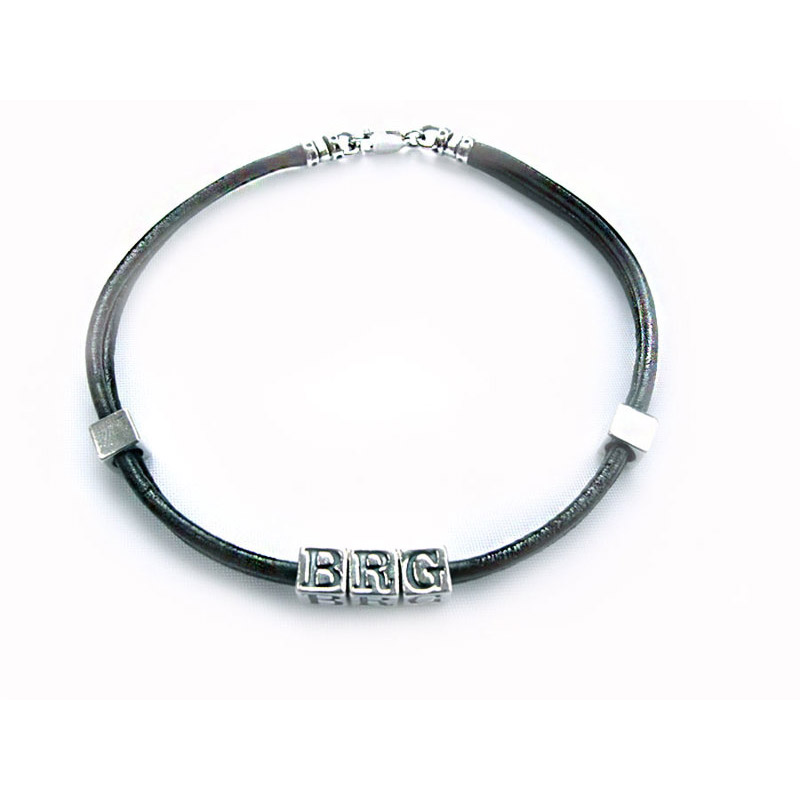 inital leather and silver wristband and boys name